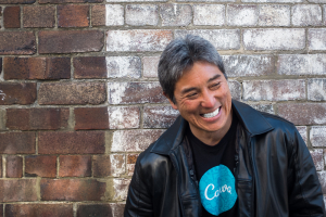 Guy Kawasaki against brick wall