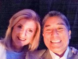 Guy and Arianna Huffington take a selfie at BlogHer