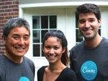 That's Melanie Perkins and Cliff Obrecht with Guy on the day he signed with Canva
