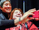 Guy takes a selfie at BlogHer
